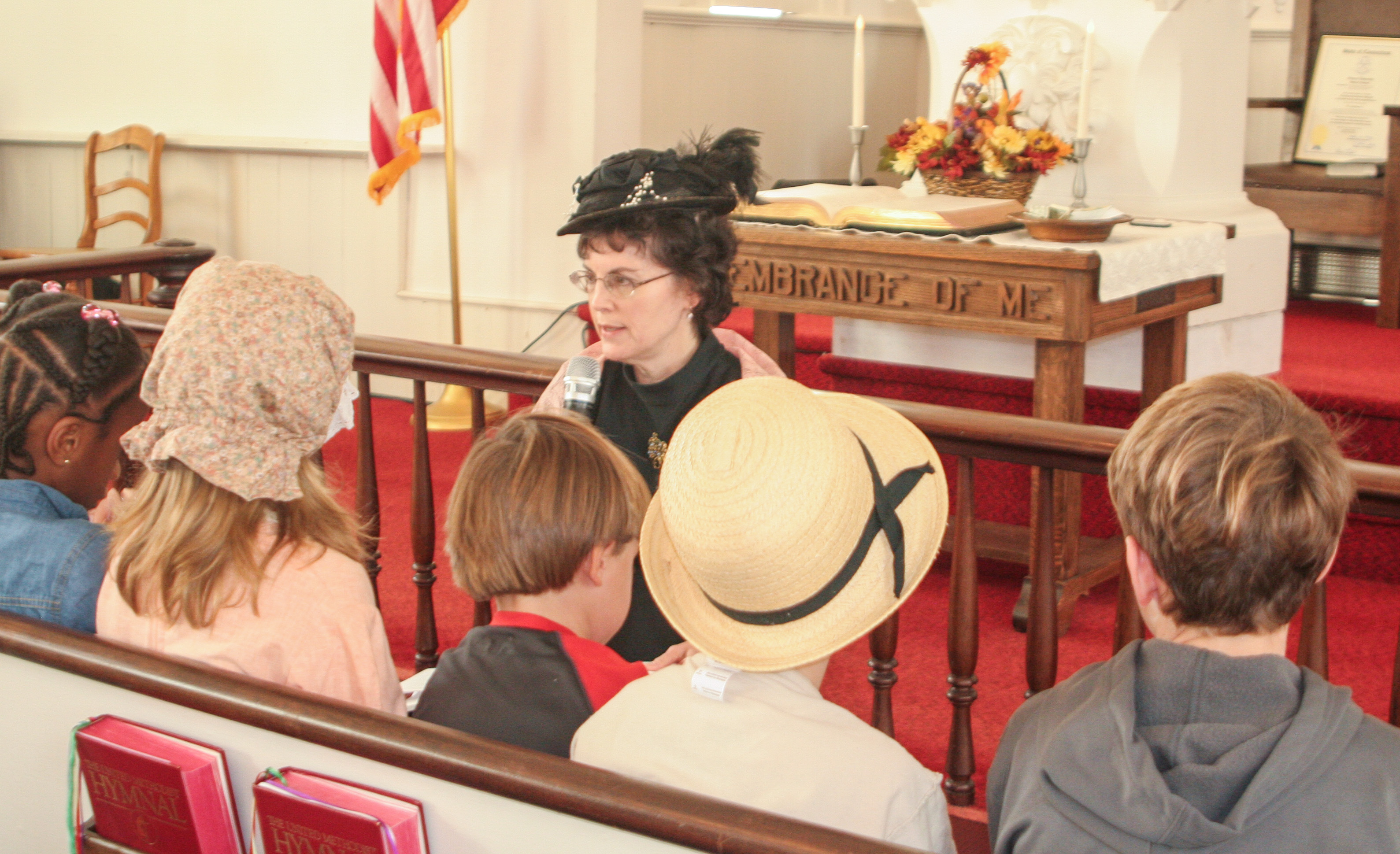 JoAnne leads children's church in costume