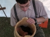 David Salvetti works on a wooden bucket with hand tool