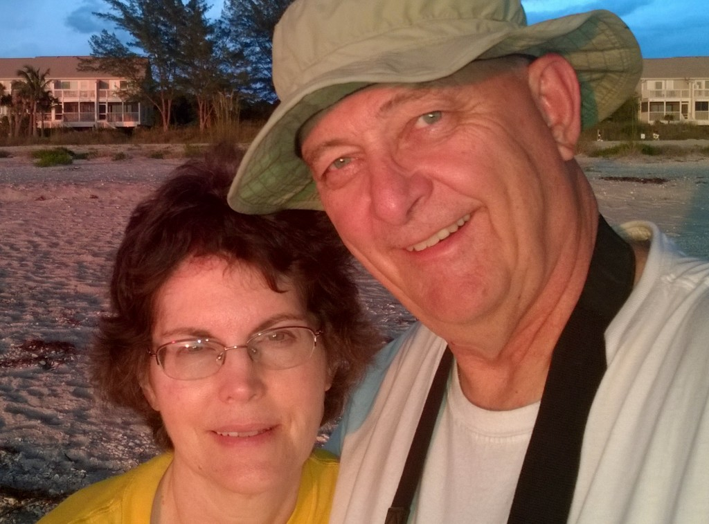 JoAnne and Kelvin walked on the white sand beach at sunset each evening