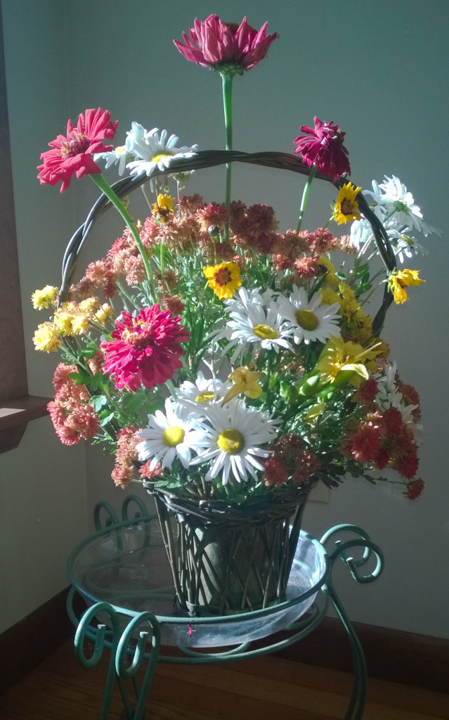 Flowers rescued from the first frost and arranged in a basket that was my grandmother's